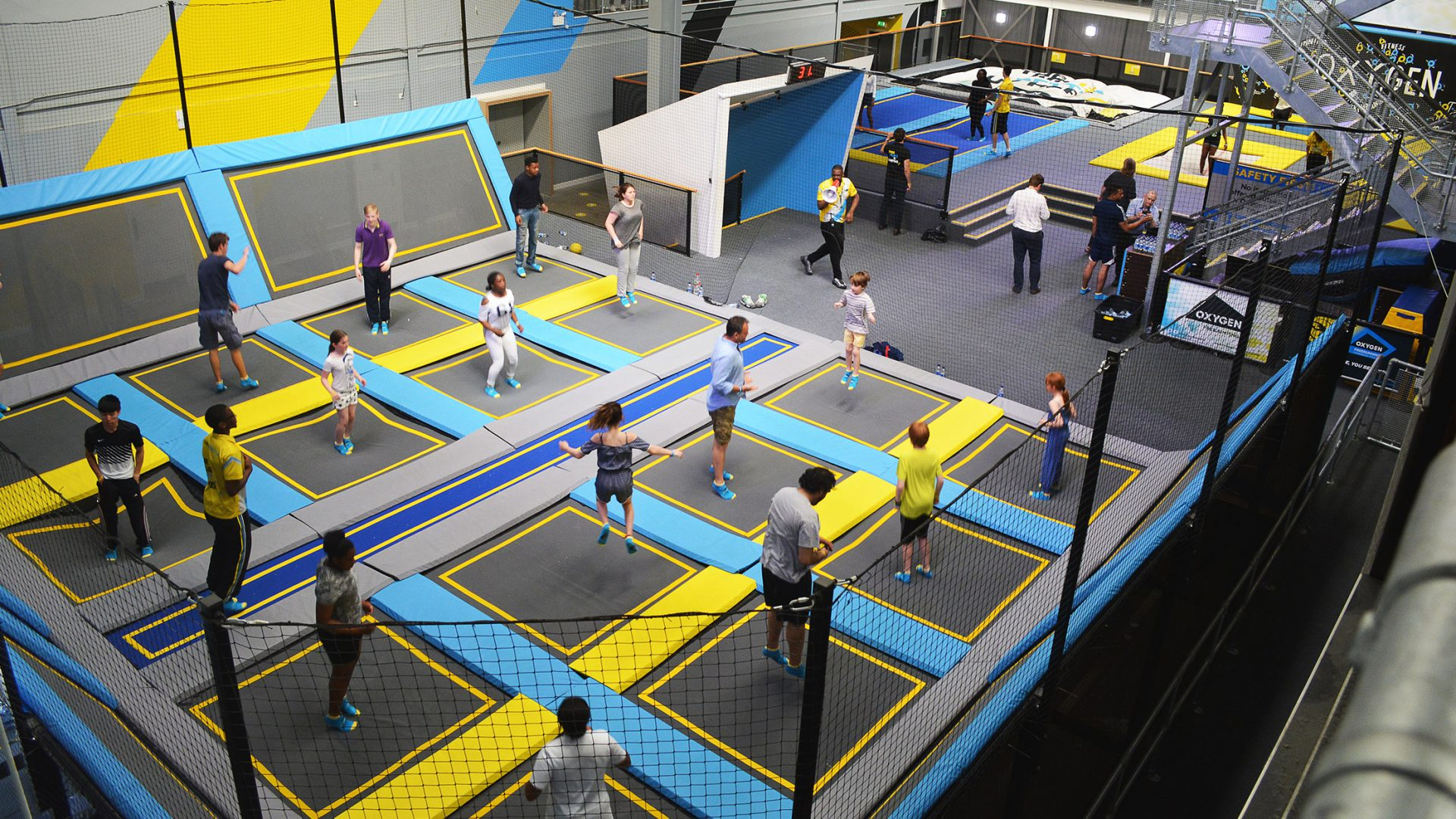 Group of people in a trampoline park