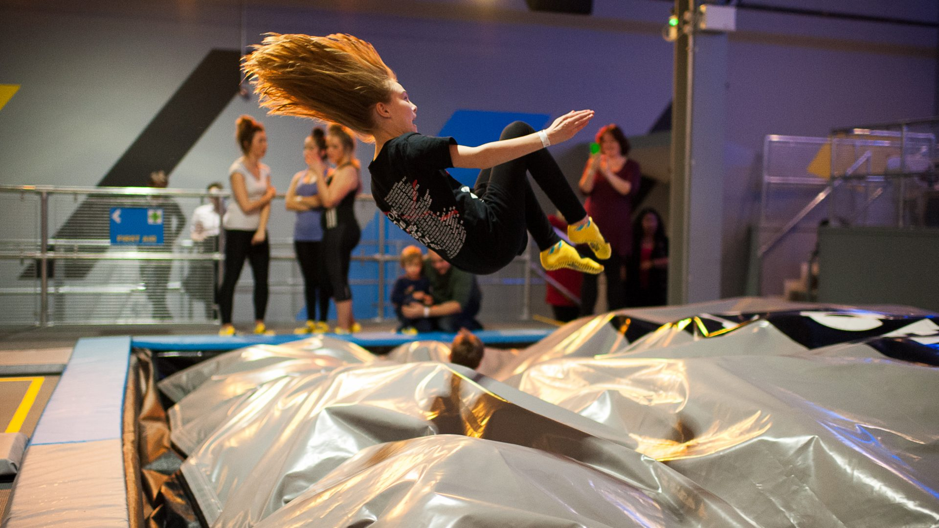 giant girl jumping into airbag in trampoline park