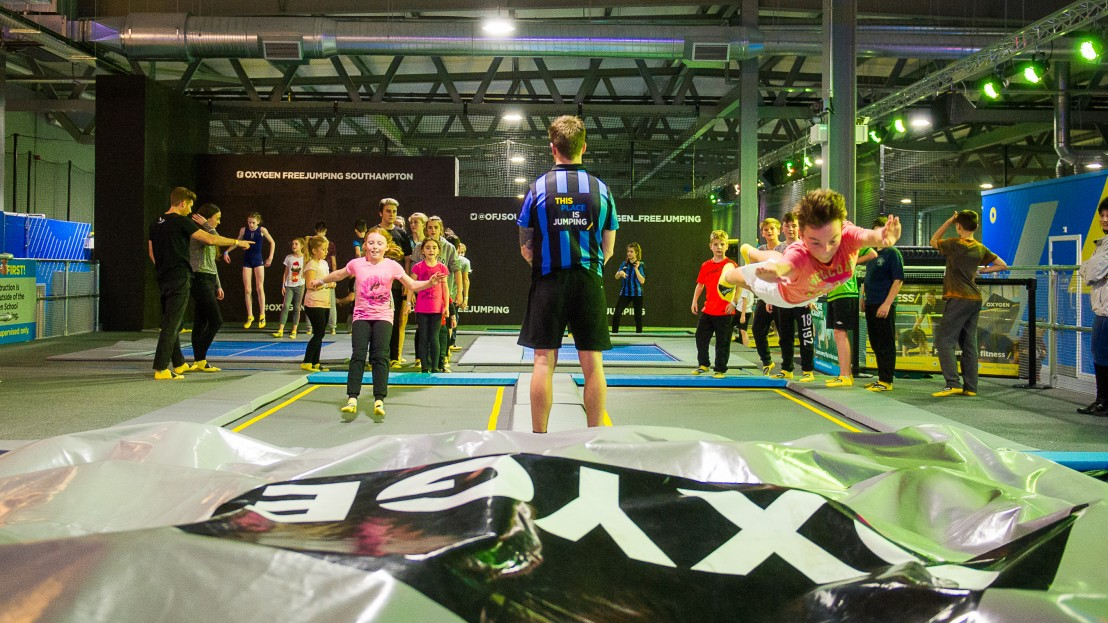 boy leaping into airbag at Oxygen Freejumping trampoline park