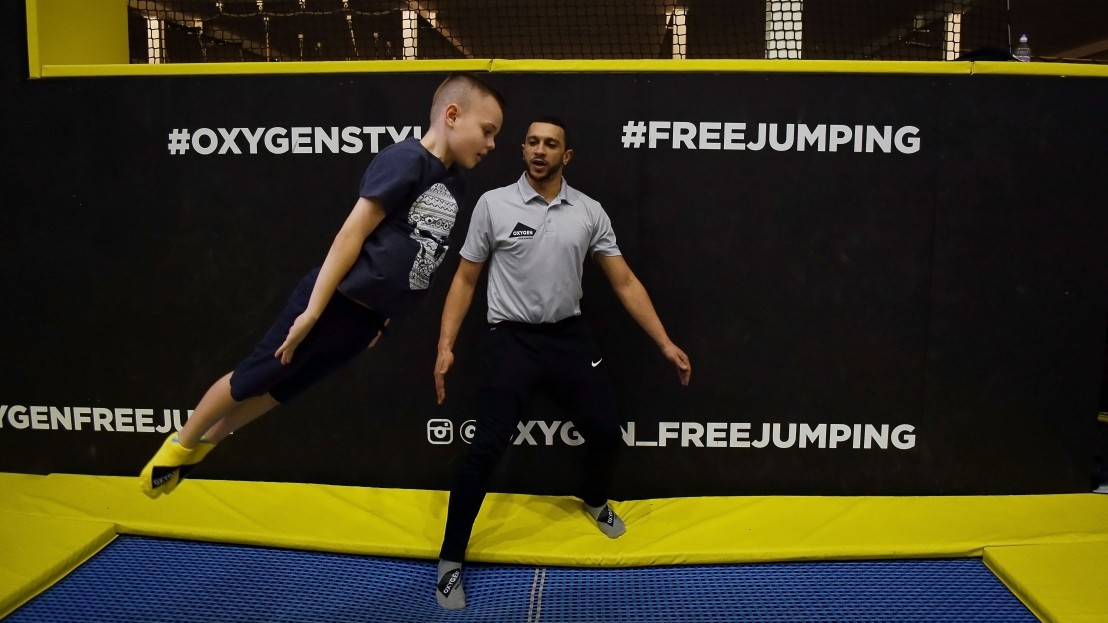 boy performs trick at Oxygen School of trampolining