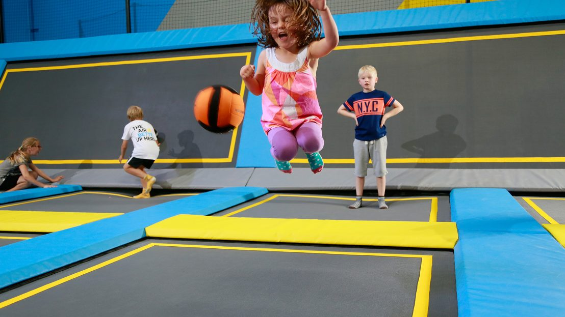 A little girl jumping in a toddler sessions at Oxygen Freejumping trampoline park