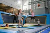 Girls throwing dodgeballs in trampoline park