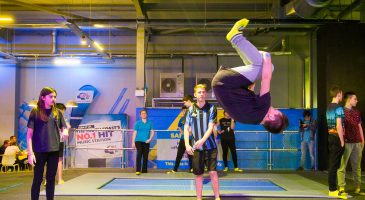 Trampolining boy somersaulting