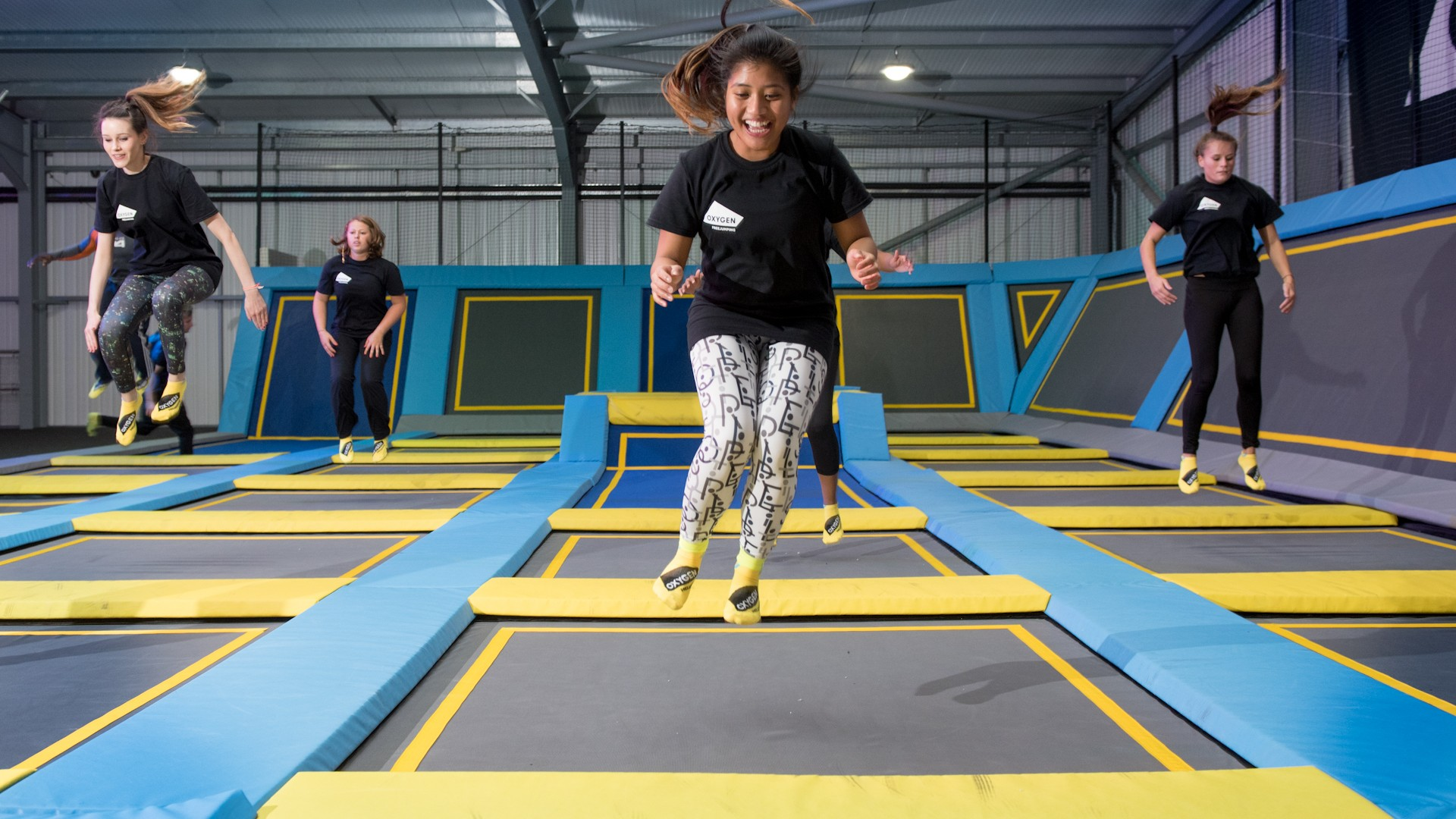 girl smiles during trampoline fitness class