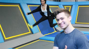 smiling lad takes his date for a bounce at Oxygen Freejumping
