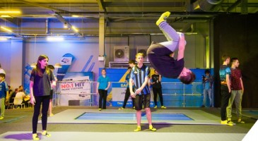 a boy flips on the professional trampolines at Oxygen Freejumping trampoline park