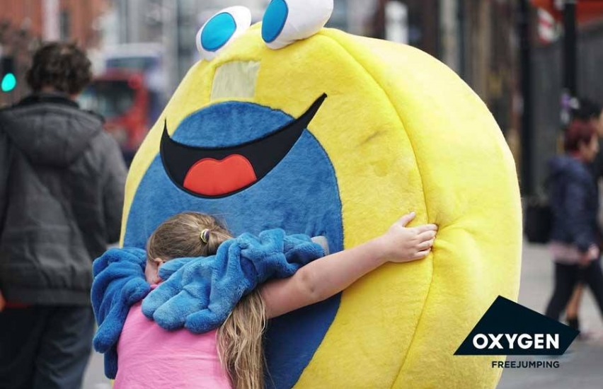 Hugging yellow mascot in Derby