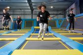 Girl in trampoline park jumping on trampolines