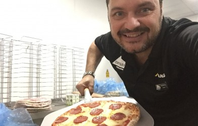 Nick Haycock serving pizza