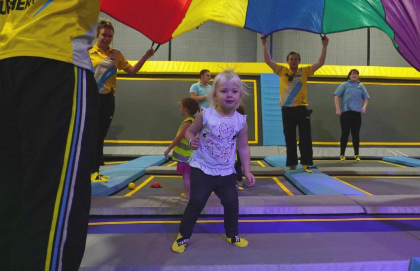 Toddlers during trampoline park party